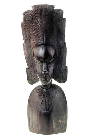 folk art: an ancient african black wood carved artifact isolated over a white background Stock Photo
