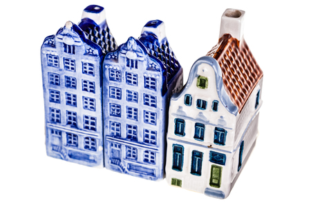 delftware: porcelain dutch canal house model isolated over a white background