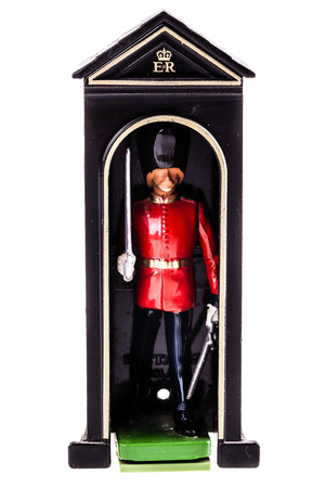 sentry: a tin british guard in a watch box isolated over a white background