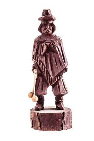 statuette: a wooden statuette of a gaucho isolated over a white background