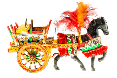 Folkloristic  traditional sicilian horse cart isolated over a white background 스톡 콘텐츠