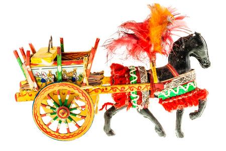 Folkloristic  traditional sicilian horse cart isolated over a white background Archivio Fotografico