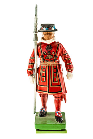 beefeater: Beefeater statuette (Yeomen Warders of Fortress Tower of London) in Tudor State Dress isolated over a white background