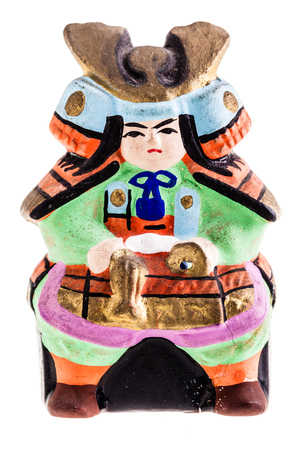 imperialism: a terracotta japanese samurai stauette isolated over a white background
