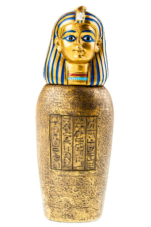 a golden canopic jar reproduction isolated over a white background