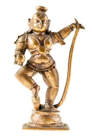 a bronze hindu goddess statuette isolated over a white background photo