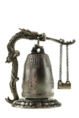 clang: a chinese temple bell miniature isolated over a white background