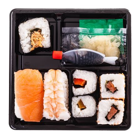 bento box: a sushi box or bento box with assorted sushi pieces isolated over a white background