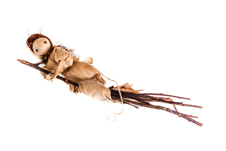 vestal: a small witch doll made of corn leaves isolated over a white background