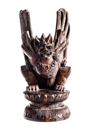benevolent: a wooden garuda statuette isolated over a white background Stock Photo