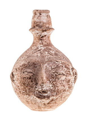 anthropomorphous: an ancient terracotta vase or jug shaped like a human face isolated over a white background