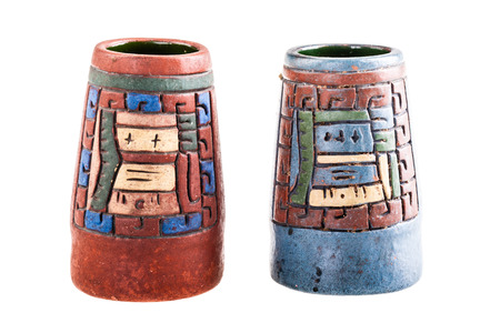 indian artifacts: two mexican inca vase isolated over a white background