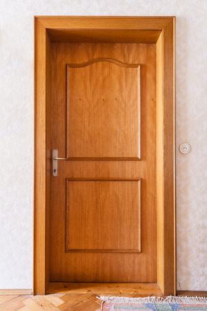 a simple wooden door in the interior of a house