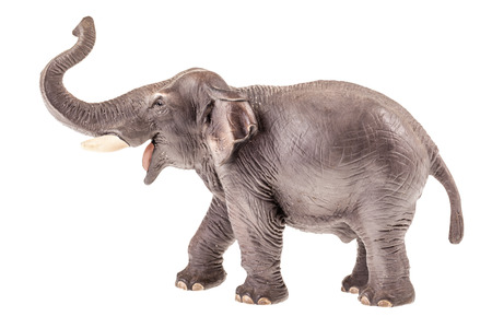 a realistic elephant figurine isolated over a white background