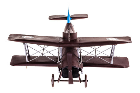 an old metal airplane toy model isolated over a white background photo