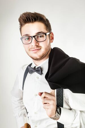 jazzbow: A handsome young man or hipster with braces and a bow tie isolated over a white