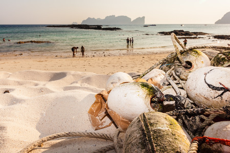 floaters: Close up shot of a fishing net abandoned on a tropical beach Stock Photo