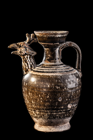 daunia: Apulian black pottery ancient canosan pitcher isolated over a black background Stock Photo
