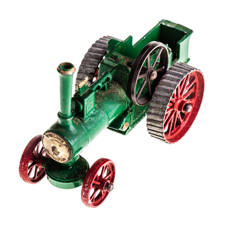engine powered: a metal model of a steam tractor isolated over a white background