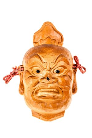 ancient japanese: an ancient japanese wooden mask isolated over a white background Stock Photo