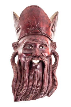 an ancient chinese wooden sage mask isolated over a white background photo
