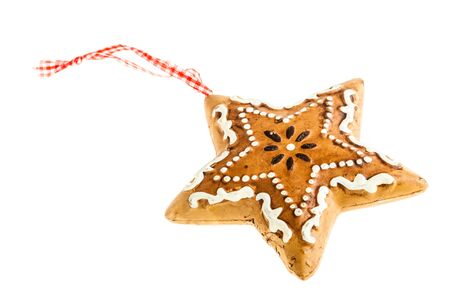 star shaped: a star shaped gingerbread christmas ornament isolated over a white background