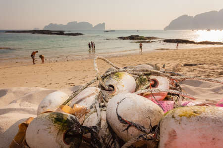 floaters: close up shot of a fishing net abandoned on a tropical beach