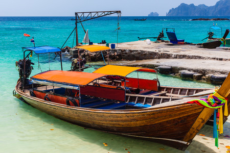 long tail: thai traditional long tail boats in a tropical setting