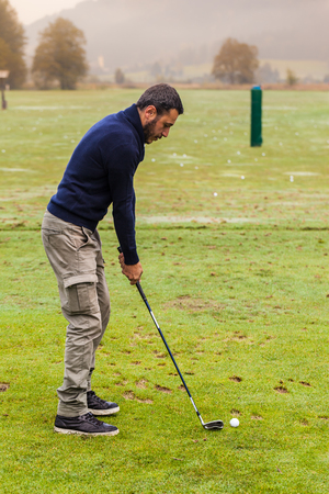 driving range: a golf player practicing the swing on the driving range