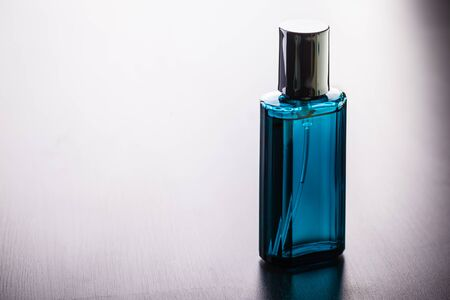 a luxurious perfume bottle on a wooden table with copy space Standard-Bild