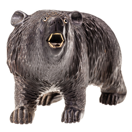 kodiak: a big wooden bear figurine isolated over a white background Stock Photo