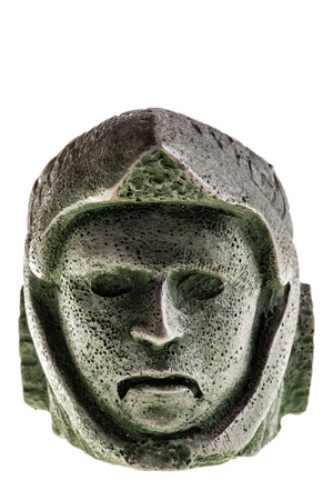 reproduction: Aztec carved eagle warrior head reproduction isolated over a white background