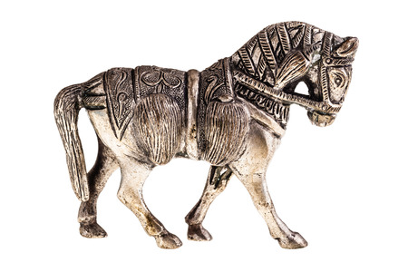 an ancient metal horse figurine isolated over a white background