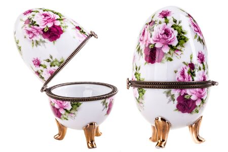 verdigris: a porcelain faberge style decorated egg isolated over a white background