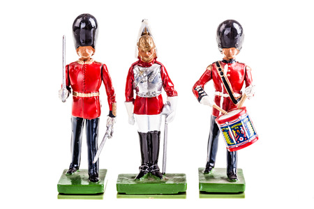 toy soldier: a regiment of tin british guards isolated over a white background
