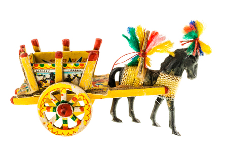 folkloristic: Folkloristic  traditional sicilian horse cart isolated over a white background Stock Photo