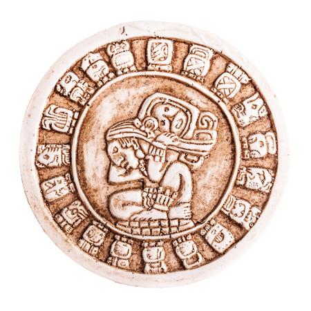 mesoamerica: stone maya calendar coaster souvenir from mexico isolated over a white background Stock Photo