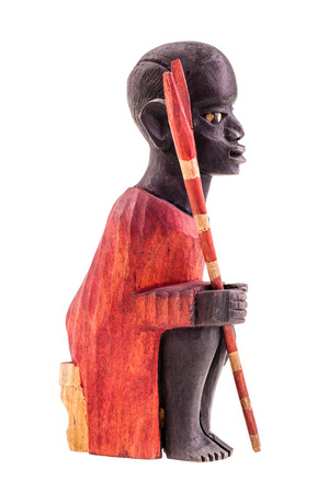 african warriors: a wooden kenya warrior figurine isolated over a white background