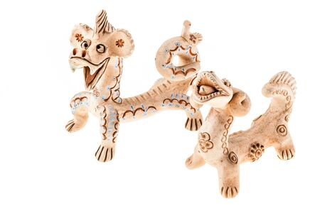 peruvian ethnicity: a clay terracotta funny dragon character isolated over a white background Stock Photo