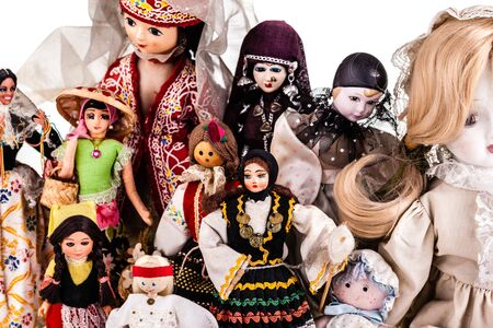 a beautiful vintage dolls collection isolated over a white background Stock Photo