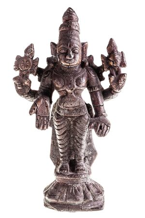 divinity: an ancient indian divinity statuette isolated over a white background
