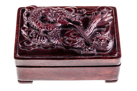 intricacy: a chinese wooden box with a dragon carved on the lid isolated over a white background Stock Photo