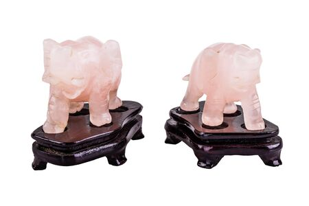 smoothen: a pink quartz elephant figurine isolated over a white background