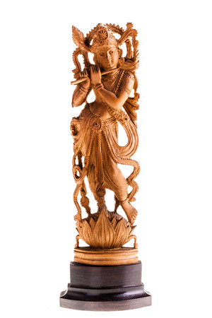 a figurine of the hindu goddess Krishna isolated over a white background