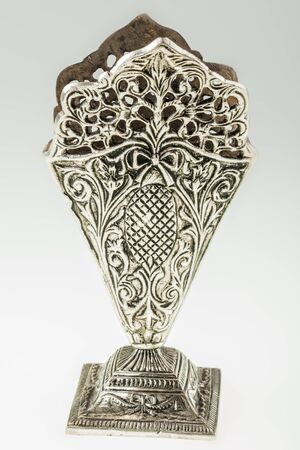 pen holder: an ancient silver pen holder with intricate carvings
