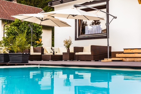 a luxurious lounge on the poolside of a beautiful big pool