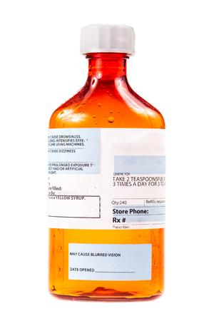 expectorant: a medicine prescription flask isolated over a white background Stock Photo