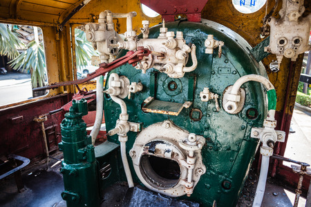 firebox: a steam locomotive engine room with the boiler and valves