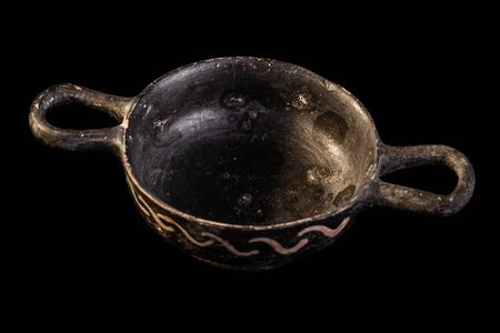 daunia: Apulian black pottery ancient canosan bowl isolated over a dark background