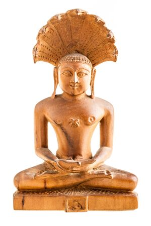shiva: a wooden buddhist statuette isolated over a white background